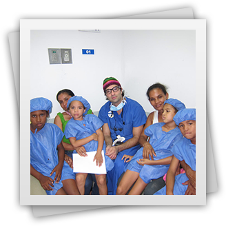 Dr. Rahban and group of kids in Guatemala getting prepped for reconstructive surgery