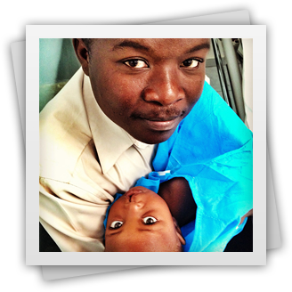 Man holding his child with a cleft diformity